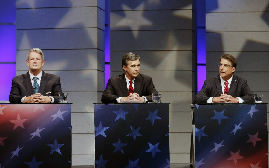Candidates for Governor of North Carolina, from left, Libertarian Lon Cecil, Democrat Roy Cooper, and Republican Gov. Pat McCrory debate at WRAL studios in Raleigh, N.C., on Tuesday, Oct. 18, 2016. (Chris Seward/Charlotte Observer/TNS)