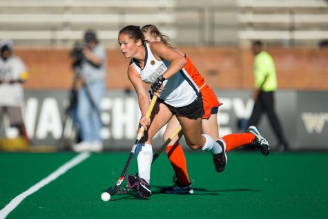 Nicola Pluta (34) of the Wake Forest Demon Deacons pushes the ball up the field during first half action against the Virginia Cavaliers in semi-final action at the 2016 ACC Field Hockey Championship at Kentner Stadium on November 4, 2016 in Winston-Salem, North Carolina.  The Cavaliers defeated the Demon Deacons 3-2 in overtime.  (Brian Westerholt/Sports On Film)