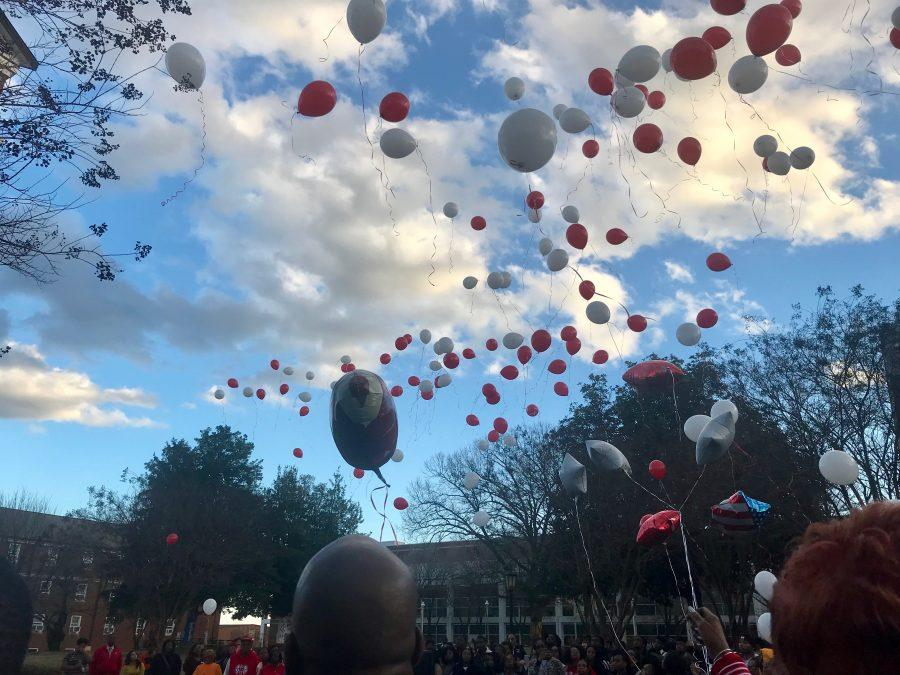 Red and White Balloons released at the vigil for Najee Ali Baker.