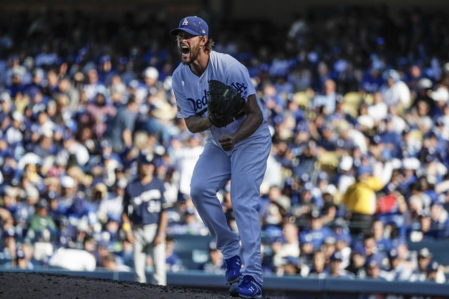 Los Angeles Dodgers pitcher Clayton Kershaw lets his emotion show while pitching against the Milwaukee Brewers in the sixth inning during Game 5 of the National League Championship Series at Dodger Stadium in Los Angeles on Wednesday, Oct. 17, 2018. The Dodgers won, 5-2, for a 3-2 series lead. (Robert Gauthier/Los Angeles Times/TNS)