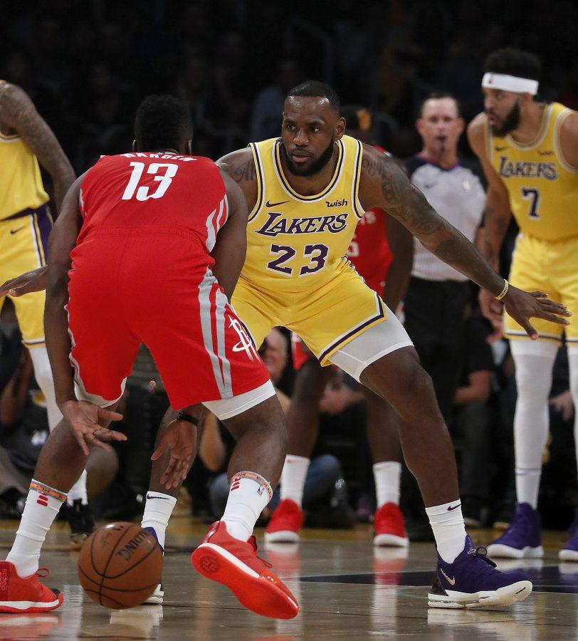 The+Los+Angeles+Lakers%27+LeBron+James+%2823%29+defends+against+the+Houston+Rockets%27+James+Harden+%2813%29+in+the+first+quarter+on+Saturday%2C+Oct.+20%2C+2018%2C+at+Staples+Center+in+Los+Angeles.+%28Luis+Sinco%2FLos+Angeles+Times%2FTNS%29