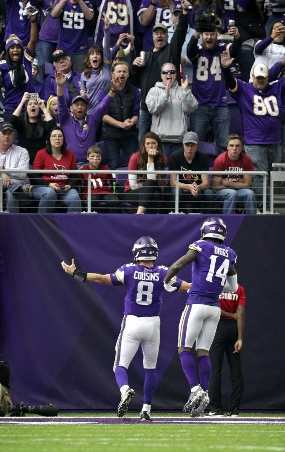 Minnesota+Vikings+quarterback+Kirk+Cousins+scores+his+first+touchdown+as+a+Viking+in+the+third+quarter+against+the+Arizona+Cardinals+on+Sunday%2C+Oct.+14%2C+2018+at+U.S.+Bank+Stadium+in+Minneapolis%2C+Minn.+%28Brian+Peterson%2FMinneapolis+Star+Tribune%2FTNS%29