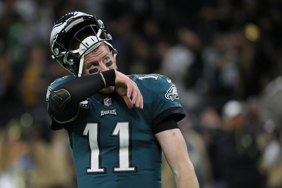 Carson Wentz watches the replay after his pass was intercepted late in the 4th quarter during the Eagles 48-7 loss to the New Orleans Saints on November 18, 2018.