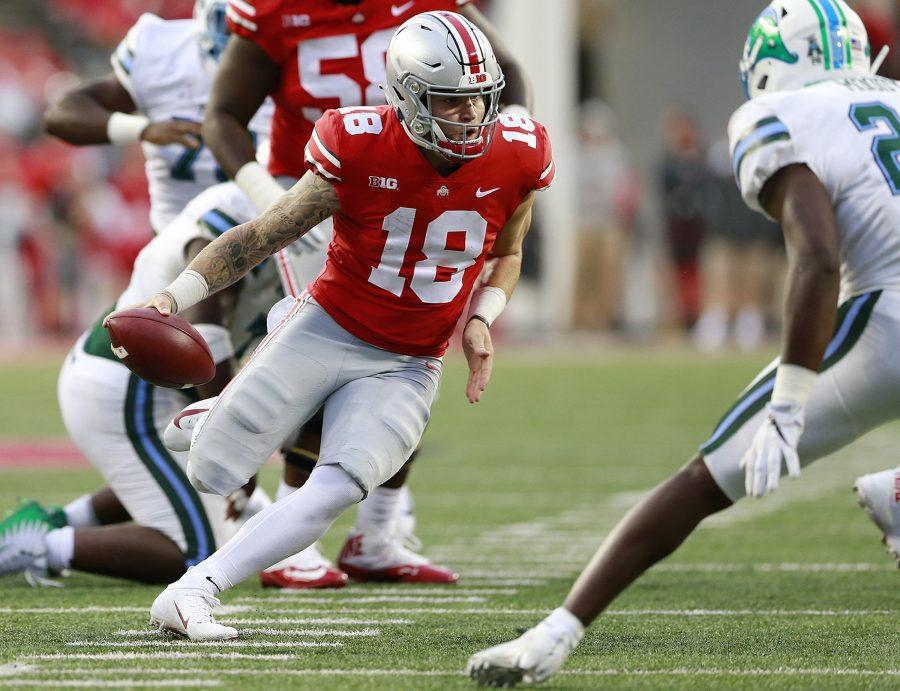 Ohio State quarterback Tate Martell (18) carries the ball in the fourth quarter against Tulane at Ohio Stadium in Columbus, Ohio, on Saturday, Sept. 22, 2018. Ohio State won, 49-6. (Brooke LaValley/Columbus Dispatch/TNS)