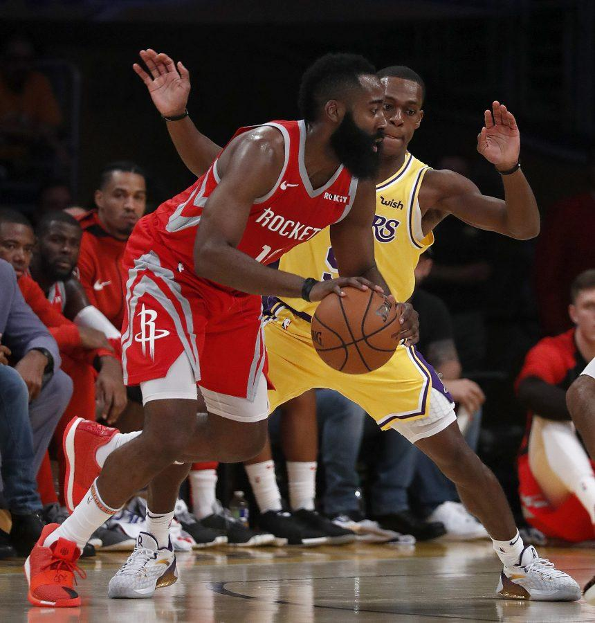 The Los Angeles Lakers' Rajon Rondo defends against the Houson Rockets' James Harden in the first quarter on Saturday, Oct. 20, 2018, at Staples Center in Los Angeles. (Luis Sinco/Los Angeles Times/TNS)
