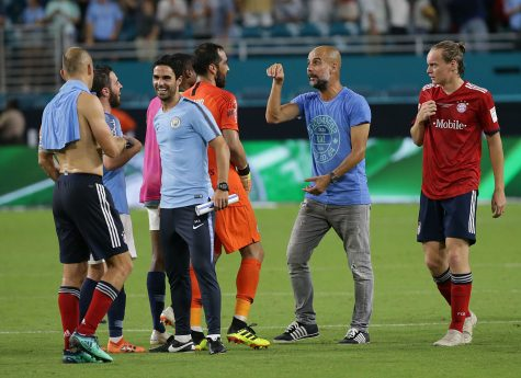 Manchester City head coach Josep Guardiola celebrates with goalkeeper Claudio Bravo and other players after a 3-0 victory against the Bayern Munich in an International Champions Cup match at Hard Rock Stadium in Miami Gardens, Fla., on Saturday, July 28, 2018. (Pedro Portal/Miami Herald/TNS)