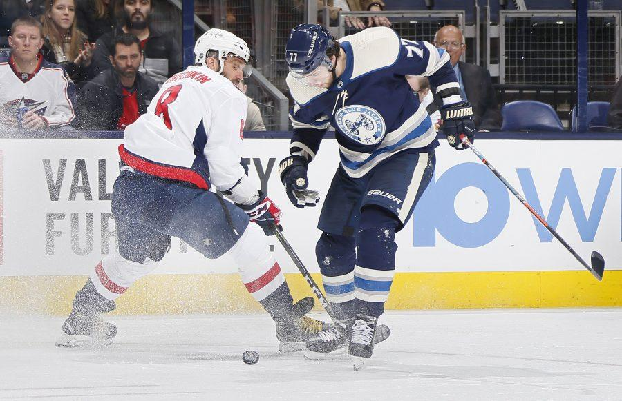 Columbus Blue Jackets right wing Josh Anderson (77) skates around Washington Capitals left wing Alex Ovechkin (8) during the third period on Tuesday, Feb. 12, 2019 of at Nationwide Arena in Columbus, Ohio. (Adam Cairns/Columbus Dispatch/TNS)