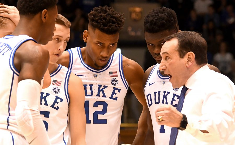 Duke head coach Mike Krzyzewski speaks with forward RJ Barrett (5), guard Alex O'Connell (15), forward Javin DeLaurier (12) and forward Zion Williamson (1) in the second half against St. John's at Cameron Indoor Stadium in Durham, N.C., on Saturday, Feb. 2, 2019. Duke won, 91-61. (Chuck Liddy/Raleigh News & Observer/TNS)