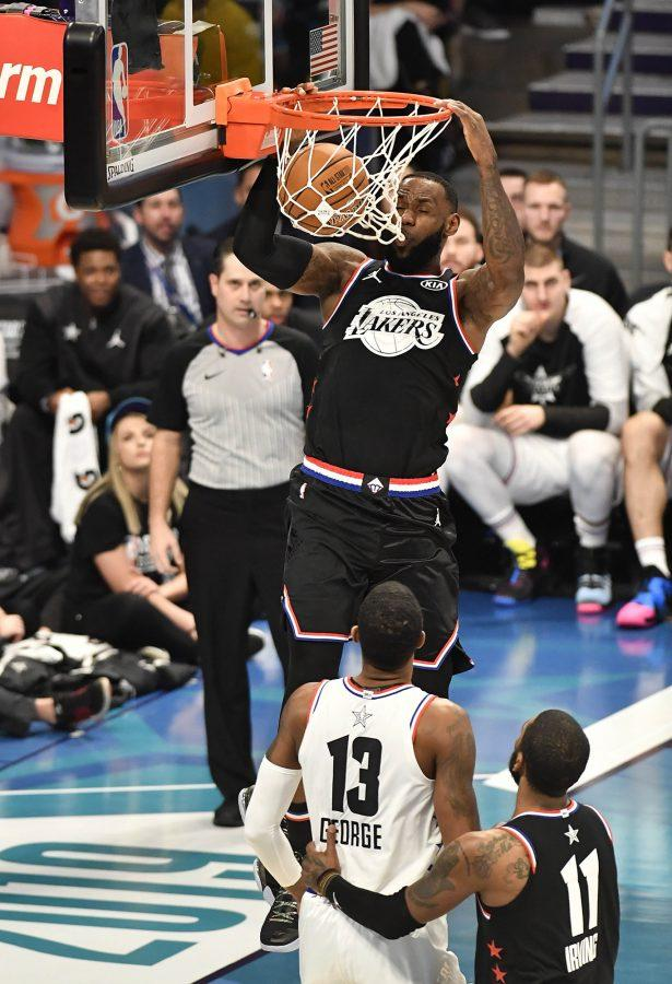 Team LeBron's LeBron James, of the Los Angeles Lakers, goes up for a dunk against Team Giannis' Paul George, of the Oklahoma City Thunder, during the second half of the 2019 NBA All-Star 2019 game at Spectrum Center in Charlotte, N.C. on Sunday, February 17, 2019. (David T. Foster III/Charlotte Observer/TNS)