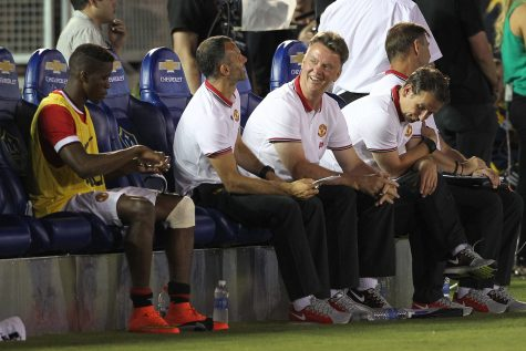 Manchester United coach Louis van Gaal, smiling, sits on the bench during an exhibition game against the Los Angeles Galaxy at the Rose Bowl in Pasadena, Calif., on Wednesday, July 23, 2014. Manchester won, 7-0. (Rick Loomis/Los Angeles Times/MCT)