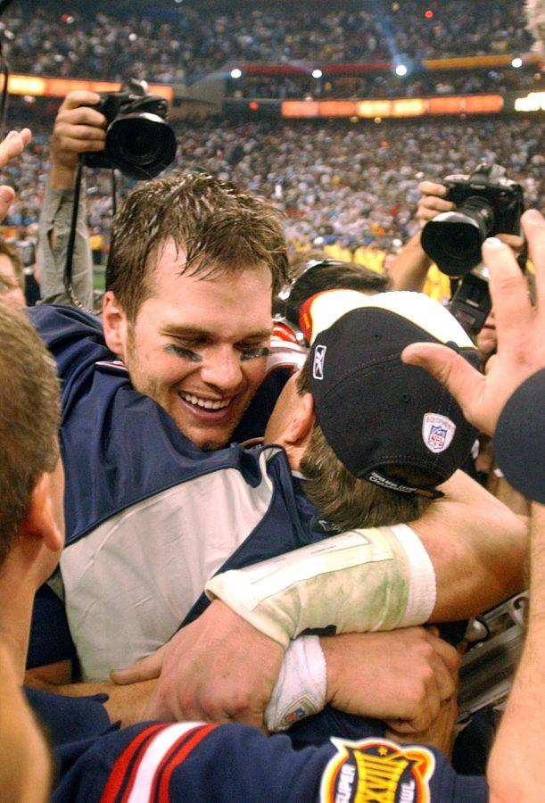 New England quarterbac Tom Brady receives a hug from head coach Bill Belichick following the New England Patriots 32-29 victory over the Carolina Panthers in Super Bowl XXXVIII at Reliant Stadium, Sunday, February 1, 2004 in Houston, Texas. (George Bridges/MCT)