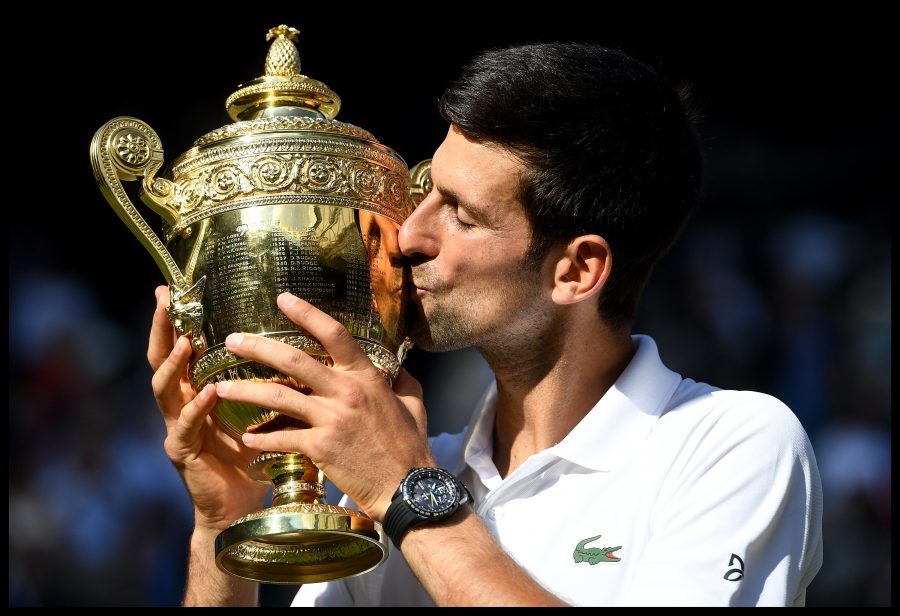 Novak+Djokovic+of+Serbia+celebrates+with+the+trophy+after+winning+his+fourth+Wimbledon+by+beating+Kevin+Anderson+in+the+Men%27s+Final+on+Centre+court+on+Day+Thirteen+of+the+Wimbledon+Tennis+Championships+on+Sunday%2C+July+15%2C+2018+in+London%2C+England.+%28Andrew+Parsons%2Fi-Images%2FZuma+Press%2FTNS%29