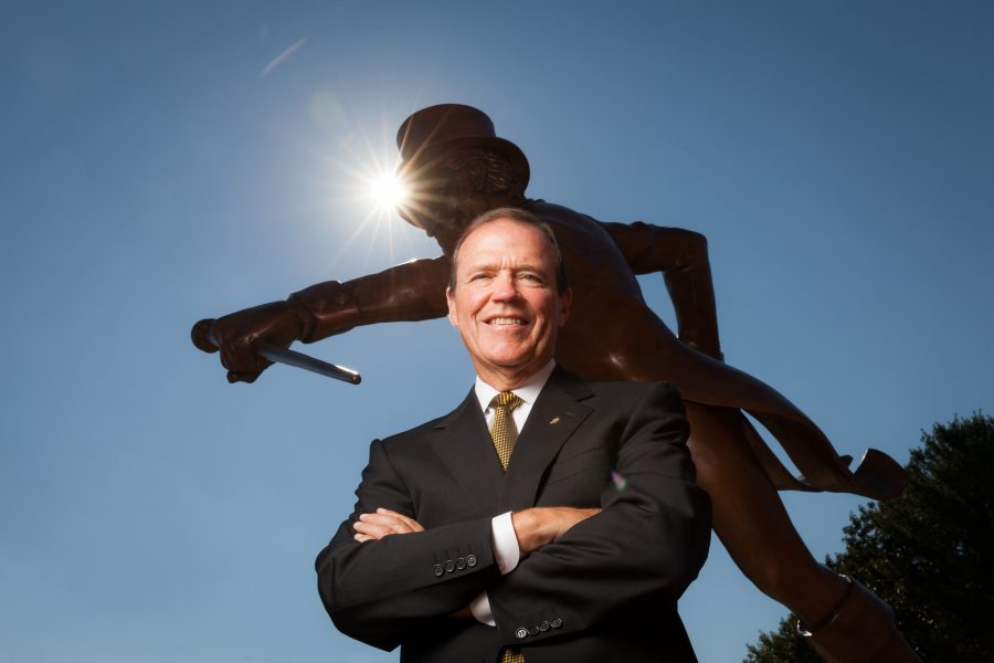 Wake Forest Athletics Director Ron Wellman poses for a portrait in front of the Demon Deacon statue at Deacon Tower on Wednesday, September 4, 2013.