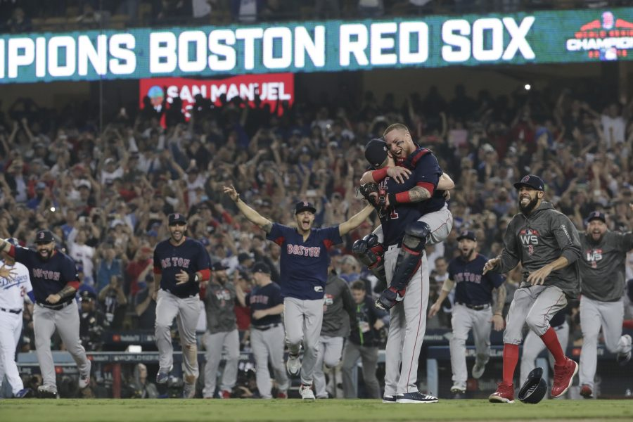 Boston Red Sox Christian Vazquez and Chris Sale celebrate winning the World Series against the Los Angeles Dodgers in Game 5 of the World Series on Sunday, Oct. 28, 2018 at Dodger Stadium in Los Angeles, Calif. (Robert Gauthier/Los Angeles Times/TNS)
