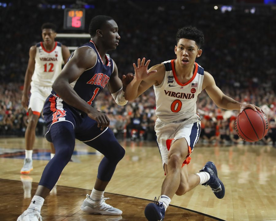 Virginia's Kihei Clark (0) drives against Auburn's Jared Harper (1) during the second half in a semifinal of the NCAA Tournament Final Four on Saturday, April 6, 2019, at U.S. Bank Stadium in Minneapolis. Virginia advanced, 63-62. (Jerry Holt/Minneapolis Star Tribune/TNS)