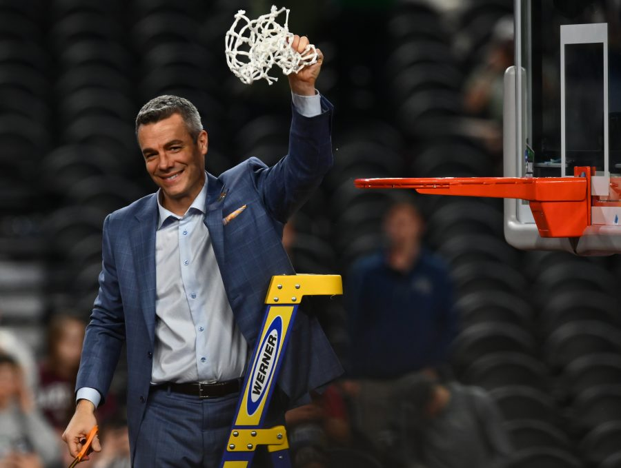 Virginia head coach Tony Bennett waves the cut down net in celebration after winning against Texas Tech 85-87 in overtime on April 8, 2019 at U.S. Bank Stadium in Minneapolis, Minn. (Aaron Lavinsky/Minneapolis Star Tribune/TNS)