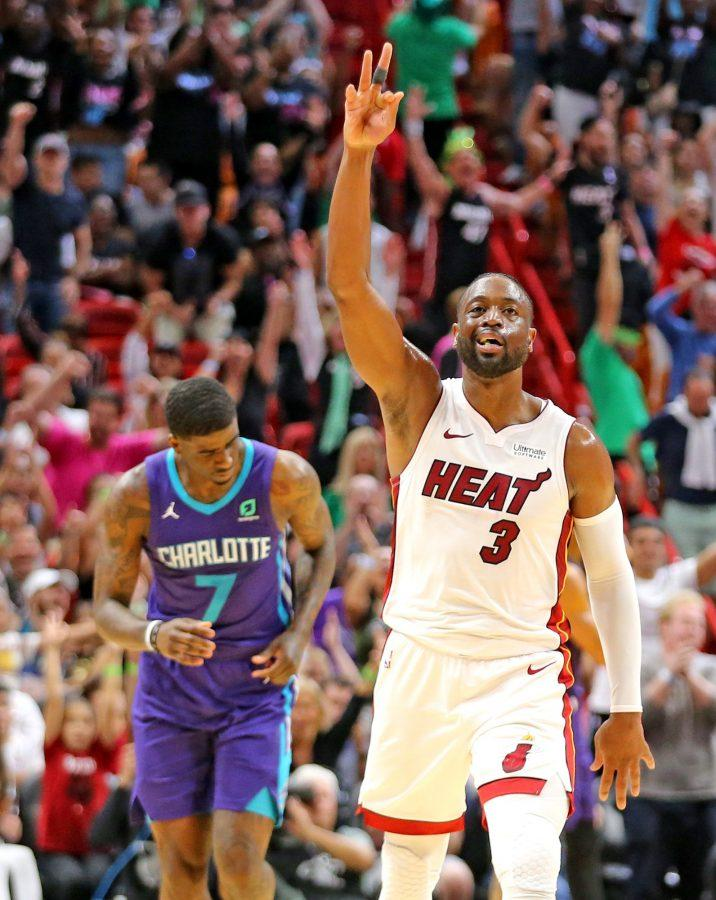 Miami Heat's Dwayne Wade signals his three-pointer in the fourth quarter against the Charlotte Hornets on Sunday, March, 17, 2019 at the AmericanAirlines Arena in Miami, Fla. (Charles Trainor Jr./Miami Herald/TNS)