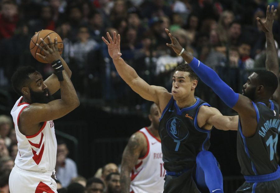 Dallas Mavericks forward Dwight Powell (7) and guard Tim Hardaway Jr. (11) work to stop Houston Rockets guard James Harden (13) during the first half on Sunday, March 10, 2019 at the American Airlines Center in Dallas, Texas. (Ryan Michalesko/Dallas Morning News/TNS)