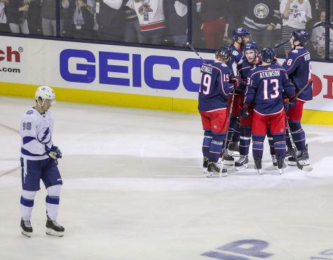 Tampa Bay Lightning defenseman Mikhail Sergachev (98), bottom, skates by as Columbus Blue Jackets teammates celebrate a second period goal by Columbus Blue Jackets defenseman Seth Jones  of Game 4 in the first round of the Stanley Cup Finals Tuesday, April 16, 2019 in Columbus. DIRK SHADD   |   Times
