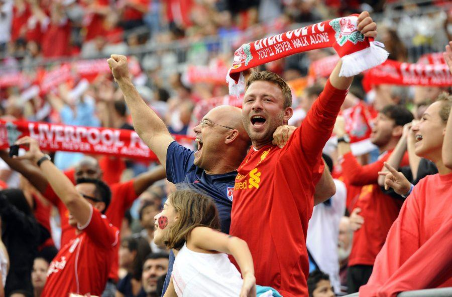 Liverpool fans stand and cheer during action against AC Milan in the semifinals of the International Champions Cup at Bank of America Stadium in Charlotte, N.C., on Saturday, Aug. 2, 2014. Liverpool won, 2-0. (David T. Foster, III/Charlotte Observer/MCT)