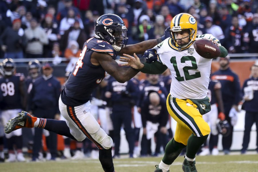 Chicago Bears outside linebacker Leonard Floyd (94) sacks Green Bay Packers quarterback Aaron Rodgers (12) near the end of the second half on Sunday, Dec. 16, 2018 at Soldier Field in Chicago. (Armando L. Sanchez/Chicago Tribune/TNS)