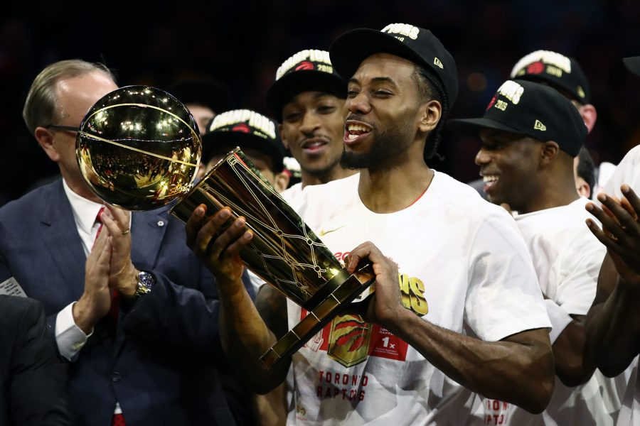 Kawhi+Leonard+of+the+Toronto+Raptors+celebrates+with+the+Larry+O%27Brien+Championship+Trophy+after+his+team+defeated+the+Golden+State+Warriors+to+win+Game+Six+of+the+2019+NBA+Finals+at+ORACLE+Arena+on+June+13%2C+2019+in+Oakland%2C+Calif.+Leonard+and+Paul+George+were+added+to+the+Clippers%27+roster.+%28Ezra+Shaw%2FGetty+Images%2FTNS%29