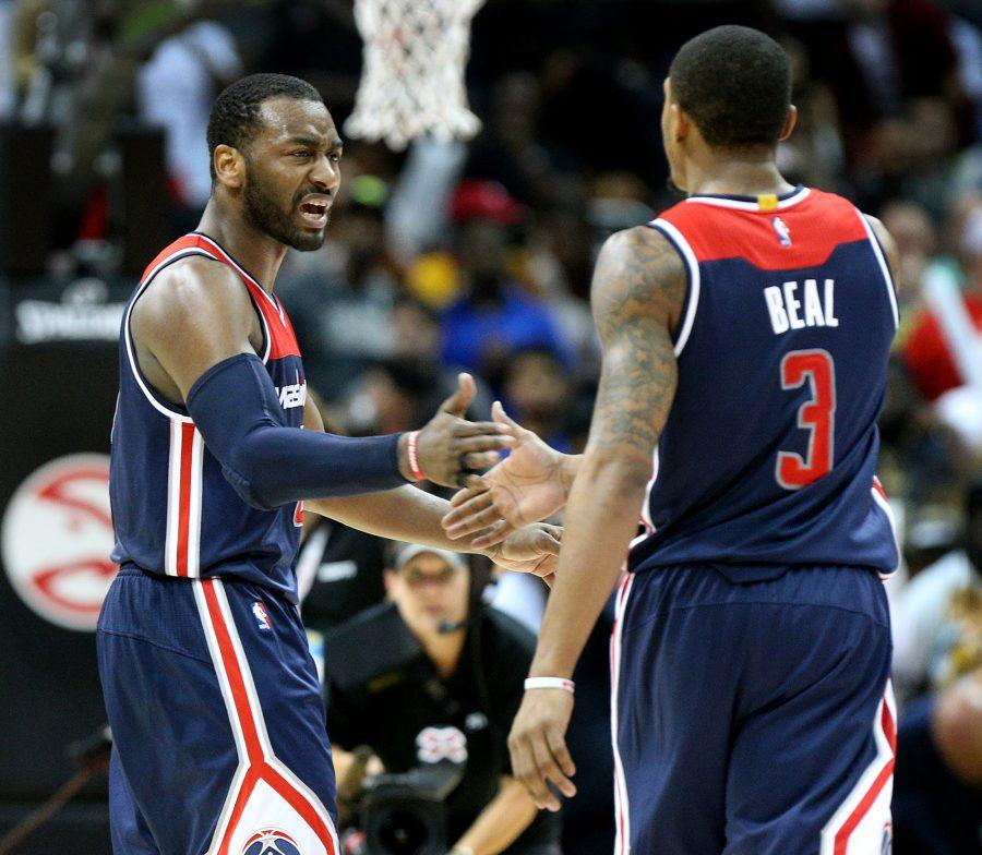 The+Washington+Wizards%27+John+Wall%2C+left%2C+and+Bradley+Beal+%283%29+celebrate+a+115-99+series-clinching+victory+against+the+Atlanta+Hawks+in+Game+6+of+the+Eastern+Conference+quarterfinals+on+Friday%2C+April+28%2C+2017%2C+at+Philips+Arena+in+Atlanta.+%28Curtis+Compton%2FAtlanta+Journal-Constitution%2FTNS%29