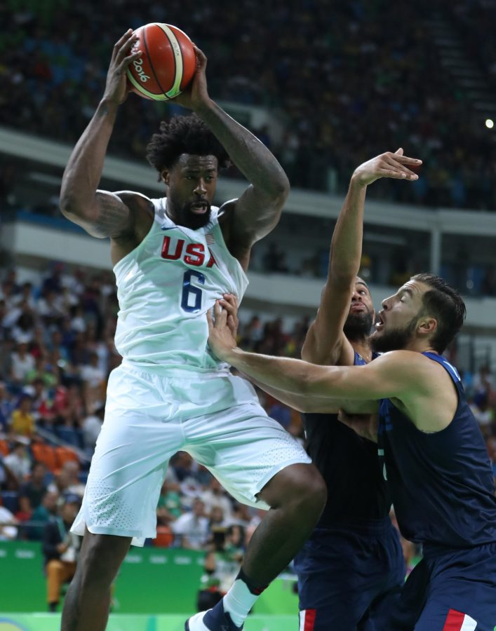 DeAndre Jordan, left, of the U.S. men's basketball team competes during a men's preliminary round match against France on Sunday, Aug. 14, 2016 at the 2016 Rio Olympic Games in Rio de Janeiro, Brazil. The U.S. won 100-97. (Meng Yongmin/Xinhua/Zuma Press/TNS)