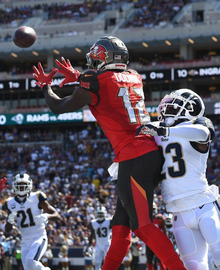 Tampa Bay Buccaneers wide receiver Chris Godwin (12) catches a touchdown pass in front of Los Angeles Rams corneback Nickell Robey-Coleman in the second quarter at the Los Angeles Coliseum on Sunday, Sept. 29, 2019, in Los Angeles. The Buccaneers won, 55-40. (Wally Skalij/Los Angeles Times/TNS)