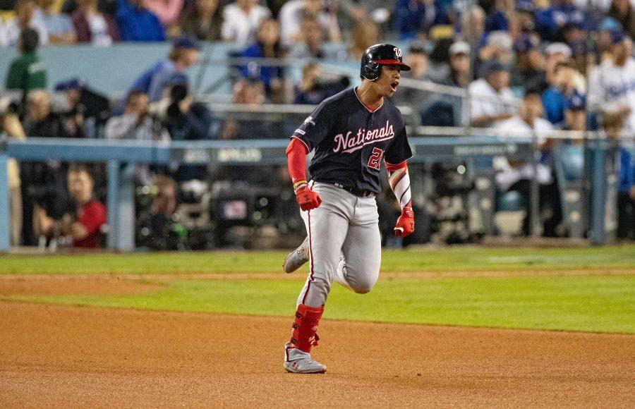 The Washington Nationals' Juan Soto (22) celebrates as he runs the bases after hitting the game-tying home run against the Los Angeles Dodgers in the eighth inning during Game 5 of the National League Division Series at Dodger Stadium in Los Angeles on Wednesday, Oct. 9, 2019. (Gina Ferazzi/Los Angeles Times/TNS)