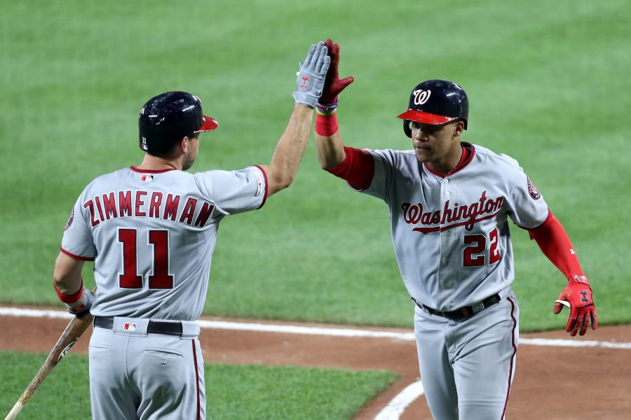 Juan Soto #22 of the Washington Nationals celebrates with Ryan Zimmerman #11 after hitting a solo home run in the sixth inning against the Baltimore Orioles at Oriole Park at Camden Yards on July 16, 2019 in Baltimore, Maryland. (Rob Carr/Getty Images/TNS) **FOR USE WITH THIS STORY ONLY**