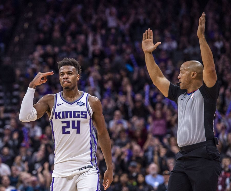 The Sacramento Kings' Buddy Hield (24) celebrates a three-point basket as referee Marc Davis signals the play against the Phoenix Suns on March 23, 2019, at the Golden 1 Center in Sacramento, Calif. (Hector Amezcua/Sacramento Bee/TNS)
