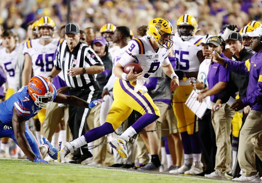 BATON ROUGE, LOUISIANA OCTOBER 12: Quarterback Joe Burrow #9 of the LSU Tigers runs the ball against the Florida Gators at Tiger Stadium on October 12, 2019 in Baton Rouge, Louisiana. (Photo by Marianna Massey/Getty Images/TNS)