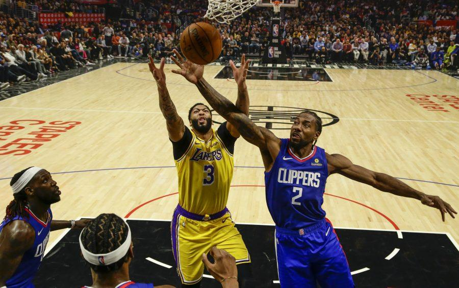 LOS ANGELES, CA, TUESDAY, OCTOBER 22, 2019 - Los Angeles Lakers forward Anthony Davis (3) and LA Clippers forward Kawhi Leonard (2) compete for a rebound at Staples Center. (Robert Gauthier/Los Angeles Times)