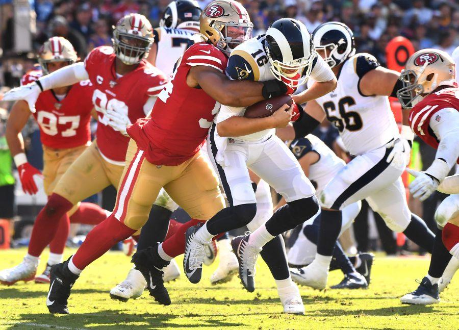 LOS ANGELES, CALIFORNIA OCTOBER 13, 2019-Rams Jared Goff is sacked by 49ers defensive lineman Solomon Thomas in the 3rd quarter at the Coliseum Sunday. (Wally Skalij/Los Angeles Times)