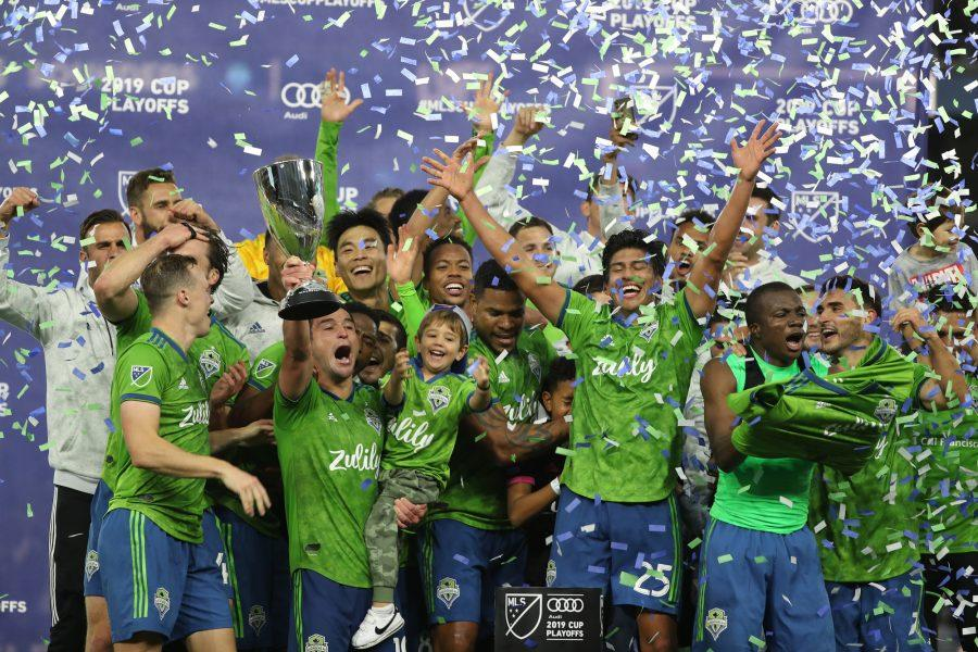 LOS ANGELES, CALIF. -- TUESDAY, OCTOBER 29, 2019: Seattle Sounders Football Club midfielder hoists the trophy as the team celebrate their 3-1 playoff win over Los Angeles Football Club at Banc of California in Los Angeles, Calif., on Oct. 29, 2019. (Allen J. Schaben / Los Angeles Times)