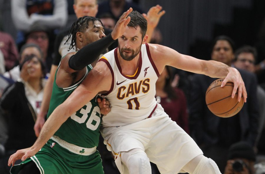 Cleveland Cavaliers forward Kevin Love works his offense guarded by Boston Celtics guard Marcus Smart in the fourth quarter, November 5, 2019, at Rocket Mortgage FieldHouse.