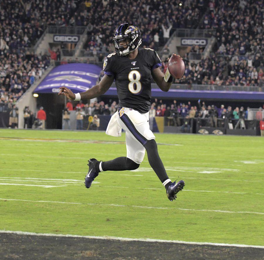 Ravens%27+%238%2C+Lamar+Jackson%2C+runs+in+for+a+score+against+the+New+England+Patriots+in+the+first+half+at+M%26amp%3BT+Bank+Stadium+on+November+3%2C+2019.