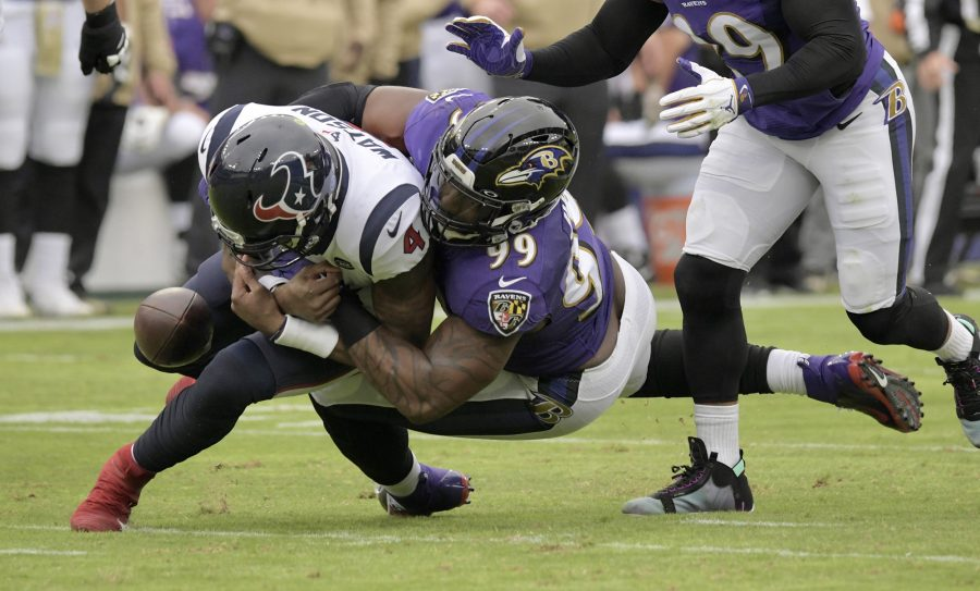 Ravens' (99), Matthew Judon forces Houston Texans quarterback (4), Deshaun Watson to fumble during the November 17, 2019 game in Baltimore, MD. (Karl Merton Ferron/Baltimore Sun/TNS)