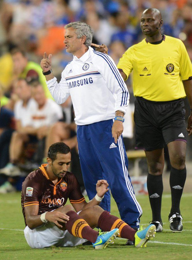 Chelsea FC coach Jose Mourinho signals to his players as AS Roma forward Mehdi Denatia (17) sits on the pitch below him in the second half of an internationals friendly at RFK Stadium in Washington, D.C., Saturday, August 10, 2013. Chelsea defeated Roma 2-1. (Chuck Myers/MCT)