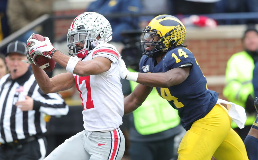 Ohio State wide receiver Chris Olave (17) catches a 57-yard touchdown pass against Michigan defensive back Josh Metellus (14) in the first quarter at Michigan Stadium in Ann Arbor, on Saturday, Nov. 30, 2019. Ohio State won, 56-27. (Kirthmon F. Dozier/Detroit Free Press/TNS)