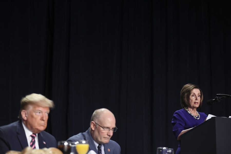 President Donald Trump, left, listens as Speaker of the House Nancy Pelosi speaks during the 68th Annual National Prayer Breakfast at the Washington Hilton in Washington, D.C., on Thursday, Feb. 6, 2020. (Oliver Contreras/Sipa USA/TNS)