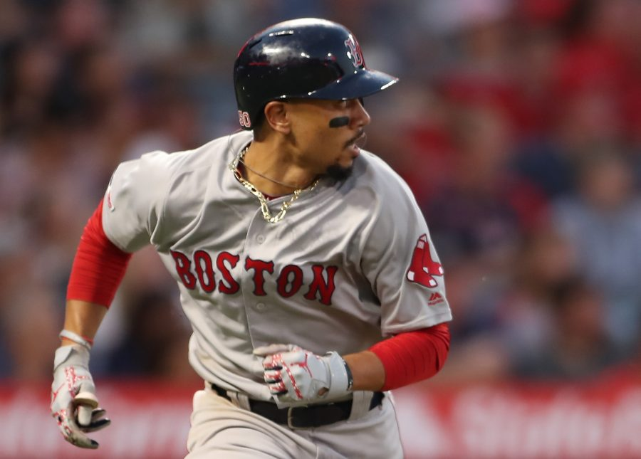 Boston Red Sox right fielder Mookie Betts (50) runs to first as he watches his hit during the game between the Boston Red Sox and the Los Angeles Angels at Angel Stadium on Aug. 31, 2019 in Anaheim, Calif. (Peter Joneleit/CSM/Zuma Press/TNS)