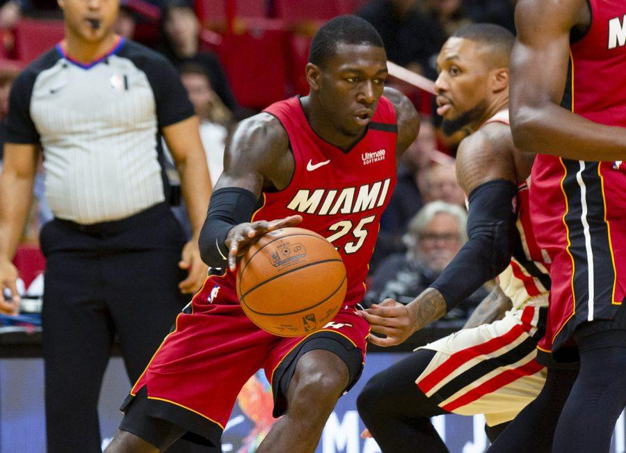 Miami Heat guard Kendrick Nunn drives to the basket past Portland Trail Blazers point guard Damian Lillard (0) during the first quarter on Sunday, Jan. 5, 2020 at American Airlines Arena in Miami, Fla. (Daniel A. Varela/Miami Herald/TNS)