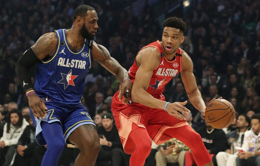 Giannis Antetokounmpo of Team Giannis dribbles past LeBron James of Team LeBron in the first quarter of the NBA All-Star Game on Sunday. [JOHN J. KIM/CHICAGO TRIBUNE]