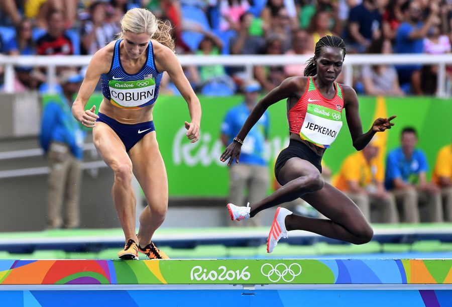 Emma Coburn, left, of the U.S. battles Kenyas Hyvin Kiyeng Jepkemoi for the silver and bronze medal on the last lap of the 3,000-meter steeplechase on Monday, Aug. 15, 2016 at the Rio 2016 Olympics in Brazil. (Wally Skalij/Los Angeles Times/TNS)