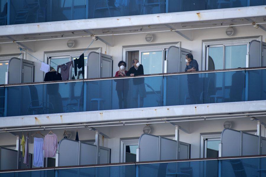 Passengers of the Diamond Princess cruise ship stand on their cabins' balconies at the Daikoku Pier Cruise Terminal in Yokohama, Japan, on February 13, 2020. (Alessandro Di Ciommo/NurPhoto/Zuma Press/TNS)