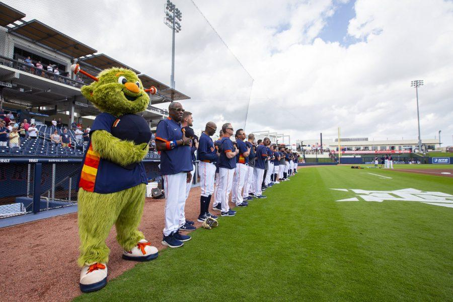 The Houston Astros baseball team line up for the national anthem ahead of a spring training game against the Miami Marlins at FITTEAM Ballpark of the Palm Beaches Tuesday, Feb. 25, 2020 in West Palm Beach, Fla. (Daniel A. Varela/Miami Herald/TNS)