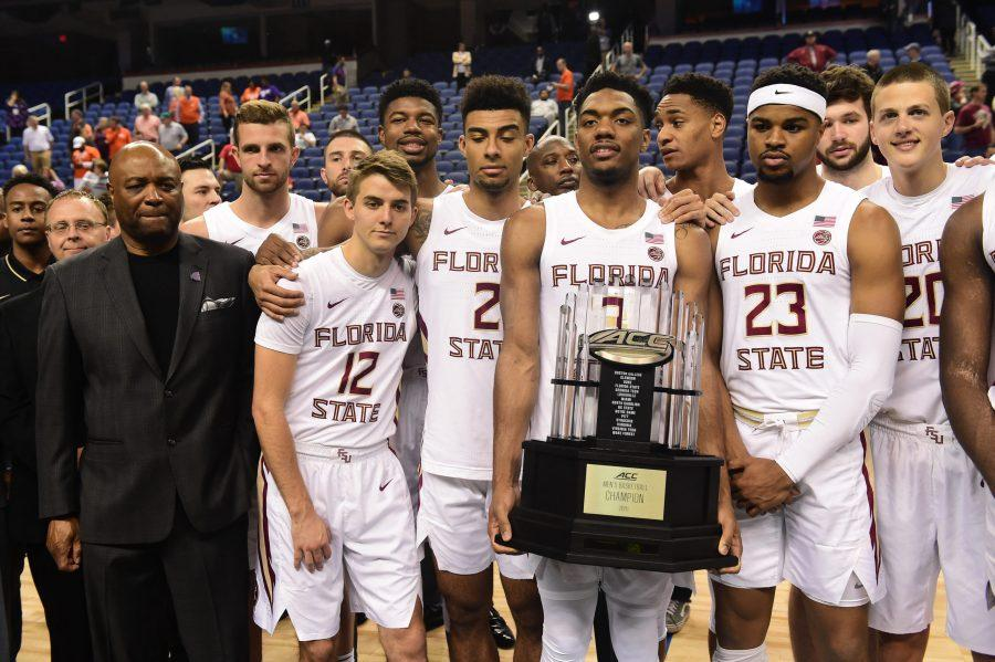 GREENSBORO, NORTH CAROLINA - MARCH 12: The Florida State Seminoles, lead by Head coach Leonard Hamilton (L), are presented with the regular season trophy following the cancelation of the remainder of the 2020 Men's ACC Basketball Tournament at Greensboro Coliseum on March 12, 2020 in Greensboro, North Carolina. The cancelation is due to concerns over the possible spread of the Coronavirus (COVID-19). (Jared C. Tilton/Getty Images/TNS)