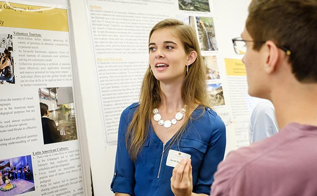 Wake Forest students show the results of their research projects during Undergraduate Research Day in the Z. Smith Reynolds Library on Friday, September 28, 2018.  Hannah Scanlon talks about music volunteering in Costa Rica and the Galapagos Islands.